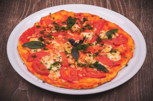 hand made pizza margarita on white plate