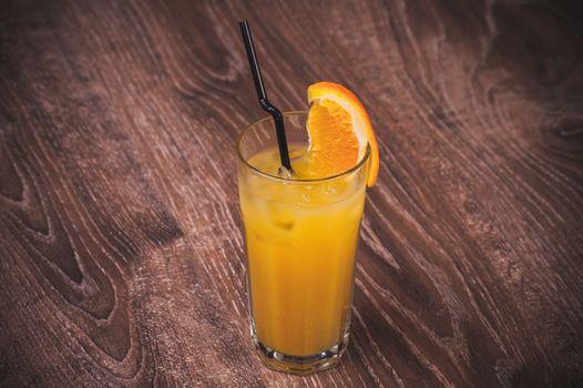 freshly squeezed orange juice in glass citrus