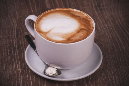 coffee cappuccino cup with milk foam with spoon