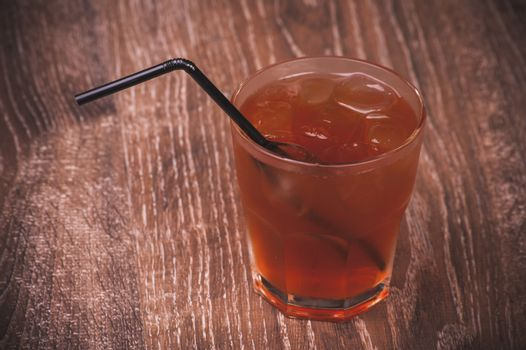 cold ice tea in glass with straw