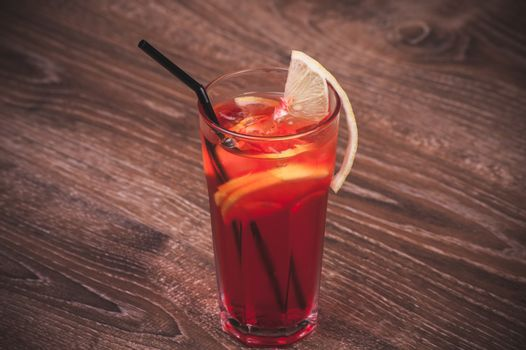 cold ice tea in glass with lemon