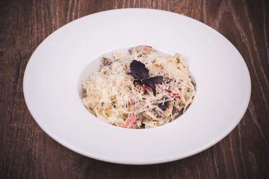 pasta with creamy mushroom sauce on white plate