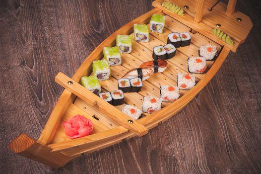 sushi roll, sashimi and nigiri boat set