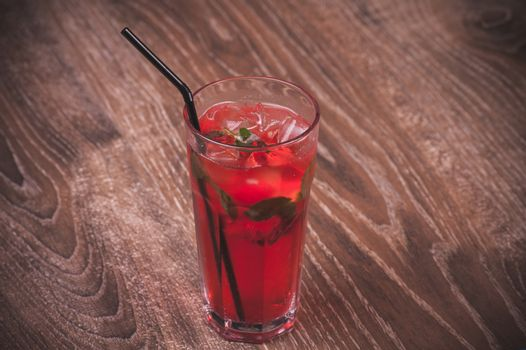 strawberry mojito cocktail with straw in glass