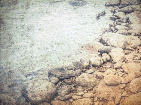 old grungy water background, stones in a sea