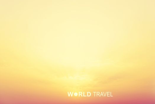 Bright sunrise sky and inscription World Travel