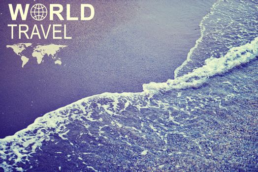 Sea wave on shore, close-up view. Inscription World Travel, related symbol and small image of Earth continents