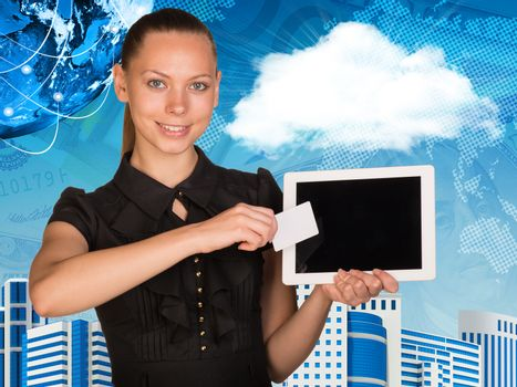 Beautiful businesswoman holding tablet PC. Globe, world map and other virtual elements as backdrop