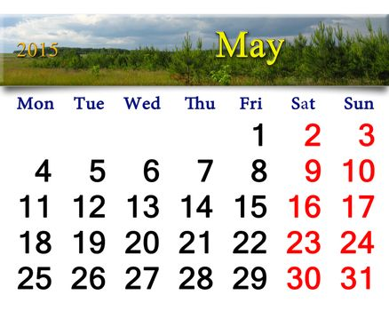calendar for May of 2015 with clouds and pines