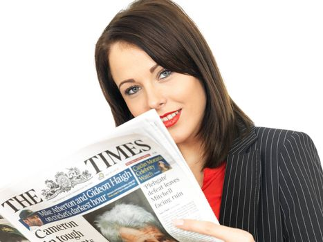 Attractive Business Woman Reading a Newspaper