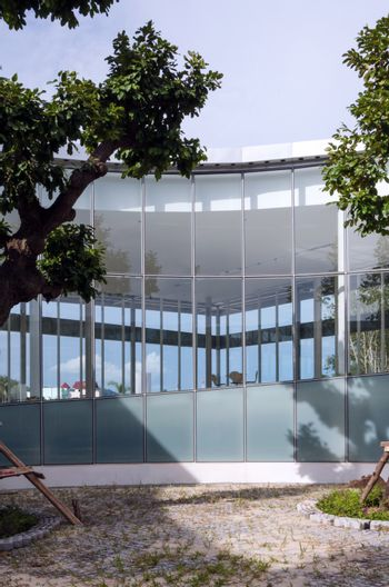 Curve glass wall of courtyard
