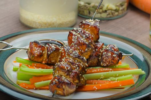 Sticky teriyaki chicken skewers with crunchy slaw