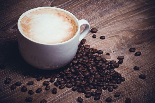 coffe with milk im mug with coffe beans