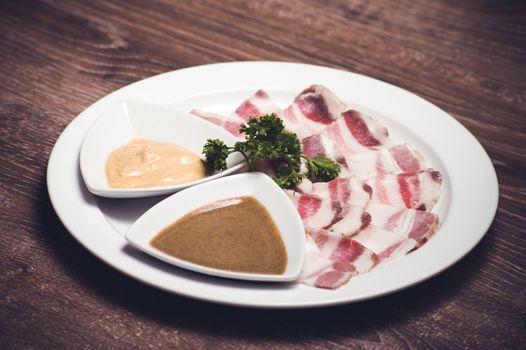 slised salo porc fat bacon with horseredish