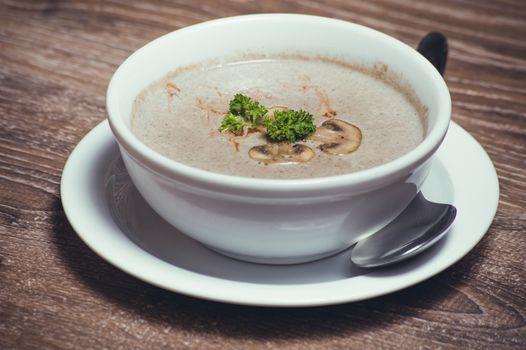tasty mushroom cream soup in white bowl