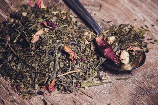 herbal tea with dried flowers on spoon