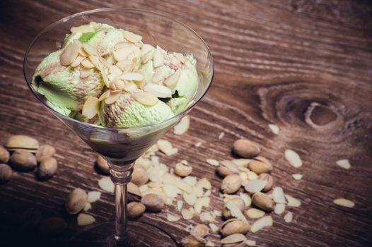 pistachio ice cream in martini glass with almond flakes