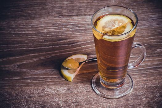 tea with lemon and honey in high glass