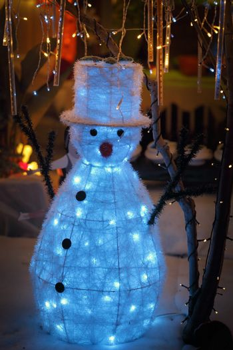 Snowman snow Christmas display with twinkling lights wonderland
