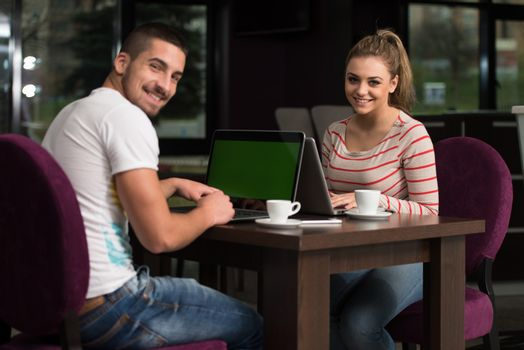 Happy Group Of Teenagers At Cafe Using Laptop