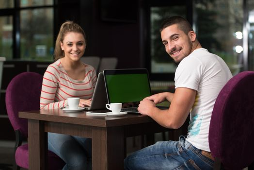 Two Teenagers With Laptop