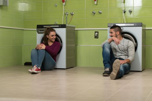 Young Couples Doing Housework Laundry