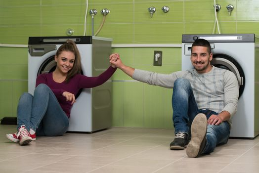 Couples Waiting For The Washing