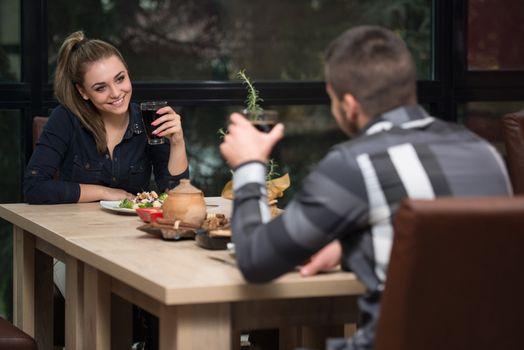 Couple Enjoying Meal In Restaurant