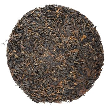 Old aged raw sheng puerh tea cake isolated closeup macro top view