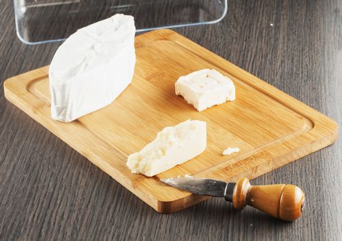 Italian and French cheese over chopping board