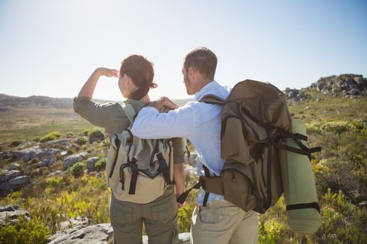 Hiking couple looking out over country terrain