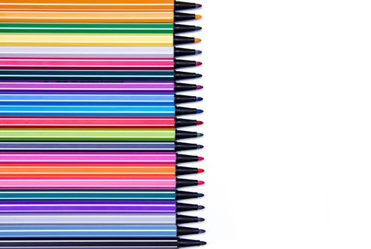 Marker pens ink in a row on white background