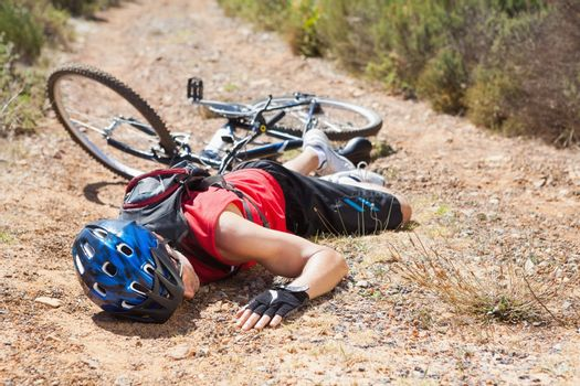 Injured cyclist lying on ground after a crash