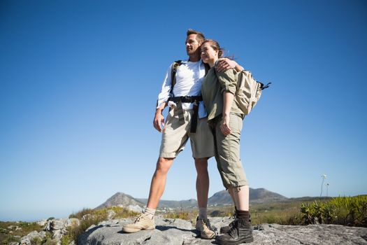 Hiking couple looking out over mountain terrain