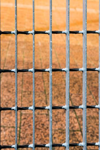 Red stone pavement behind bars background