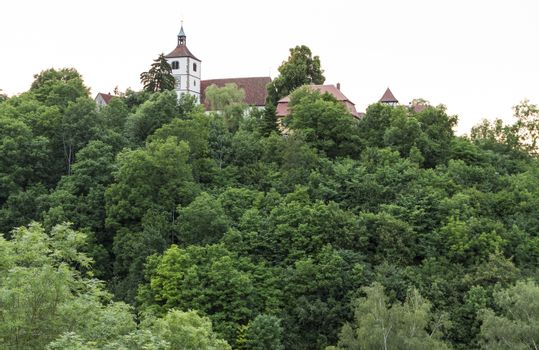 historical building in south west Germany  hidden behind trees. horizontal image