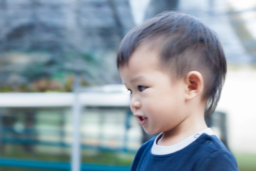 Little asian boy play at playground, stock photo