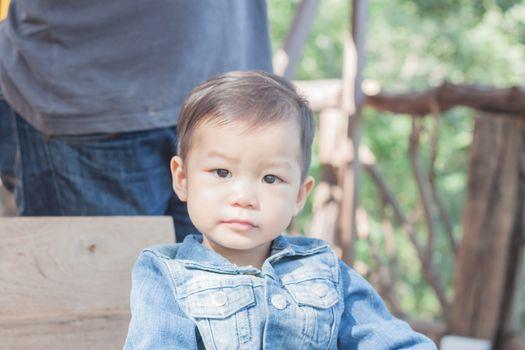 Cute asian boy looking at camera, stock photo