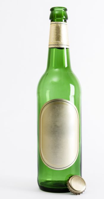 empty green beer bottle with crown seal