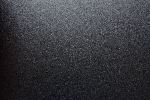 Black Abstract Textured Background with Spotlight