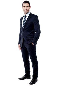 Handsome entrepreneur posing over white