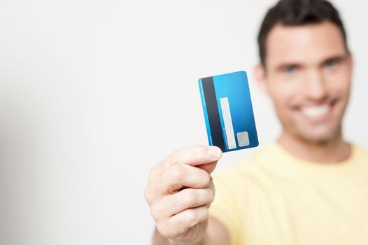 Handsome man holding debit card