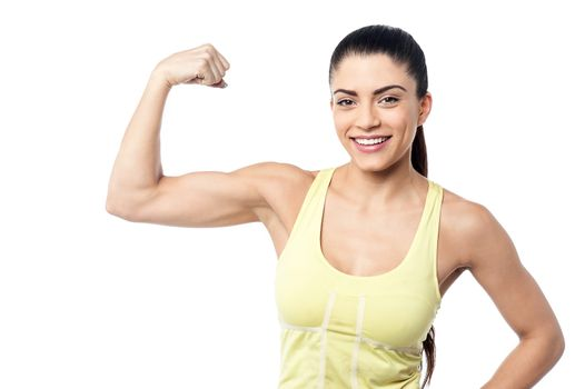Strong sporty woman posing