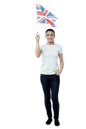 Cheering for nation, woman holding UK flag