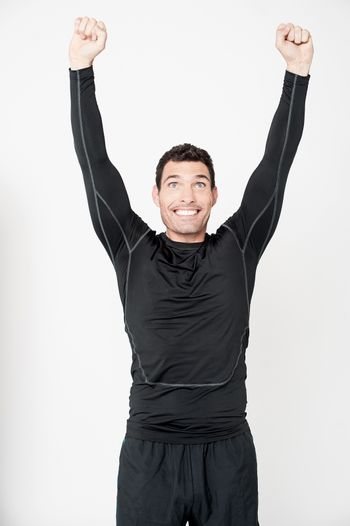 Fitness male athlete celebrating his success