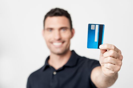 Happy man with credit card
