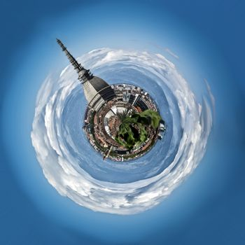 Panoramic view of Mini planet or globe of Turin city center, in Italy, in a sunny day, with Mole Antonelliana, Alps and cloudy sky around it