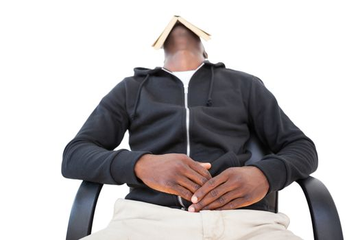 Man sleeping in swivel chair with book over face