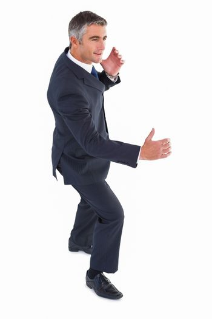 Cheerful businessman well dressed posing