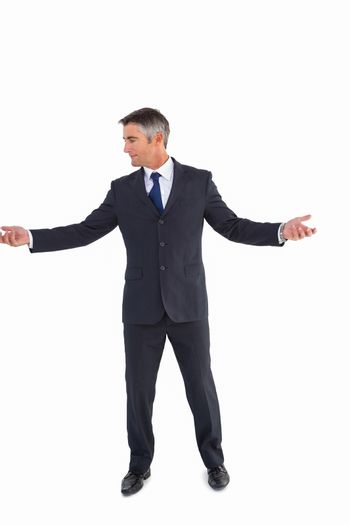 Businessman well dressed spreading his arms